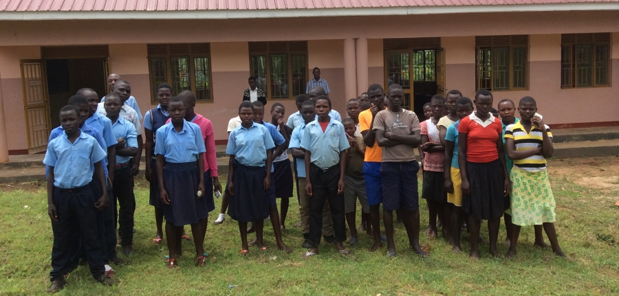 Students in front of phase 1 of community secondary school in Butta, Uganda